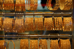 Gold jewelry for sale in the market Stock Image