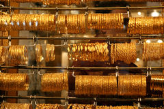 Gold jewelry for sale in the market Royalty Free Stock Photography