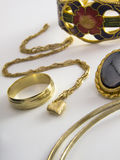 Gold jewelry set. Gold jewelry isolated in white background royalty free stock photography