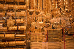Gold jewelry in the shop window Royalty Free Stock Photos