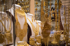 Gold jewelry in the shop window Stock Photography