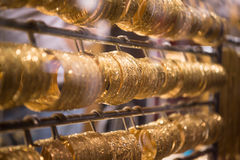 Gold jewelry in the shop window Stock Image