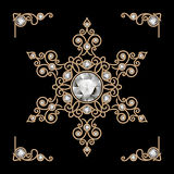Gold jewelry snowflake Stock Photos