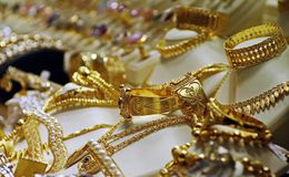 Gold jewellery for sale in shop Stock Photos