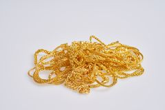 Gold jewelry on white background. stock photo