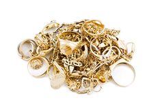 Gold jewelry. On a white background royalty free stock photos
