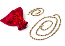 Gold jewelry on a white background Royalty Free Stock Photos