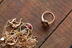 Gold Jewelry On Wood Royalty Free Stock Photography
