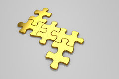 Gold jigsaw puzzle. Royalty Free Stock Photography