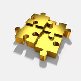 Gold jigsaw puzzle. Royalty Free Stock Photos