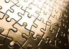 Gold jigsaws Royalty Free Stock Photos