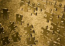 Gold jigsaws Stock Photo