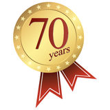 Gold jubilee button - 70 years Stock Images
