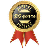 Gold jubilee seal. Seal colored black and gold with red ribbons for twenty years jubilee Royalty Free Stock Image