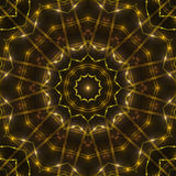 Gold kaleidoscope light, dark abstract background. Dark abstract background, gold kaleidoscope light Royalty Free Stock Image