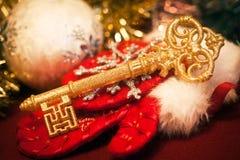 Gold key. Against Christmas toys Stock Image