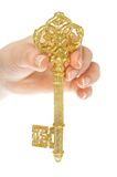 Gold key. In hands of the person stock images