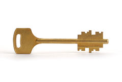 Gold Key. On white with soft shadow Royalty Free Stock Photo