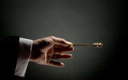 Gold key Stock Photos