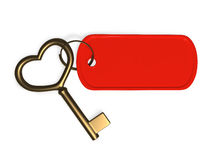 Gold key. With red tag attached Stock Photography