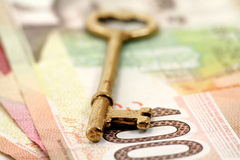 Gold key and canadian dollars Stock Image