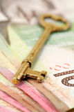 Gold key and canadian dollars Royalty Free Stock Photography