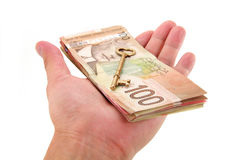 Gold key and canadian dollars Royalty Free Stock Image