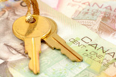 Gold key and canadian dollars Royalty Free Stock Photos