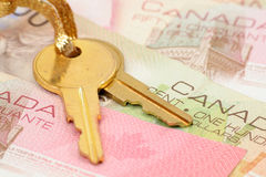 Gold key and canadian dollars Stock Photo