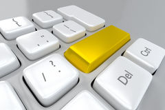 Gold key on a computer keyboard Stock Photo