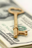 Gold key and dollars Royalty Free Stock Photos