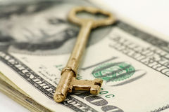 Gold key and dollars Stock Image