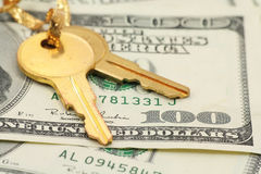 Gold key and dollars. Concept of success Royalty Free Stock Photo