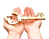 Gold key. In hands of the person isolated on white background Royalty Free Stock Images