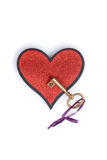 Gold key on a heart Royalty Free Stock Photography