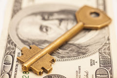 Gold key on hundred dollar bill Stock Photos