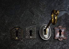 Gold key and locks Royalty Free Stock Photos