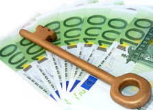 Gold key and money. Golden key and seven hundred euros Royalty Free Stock Image