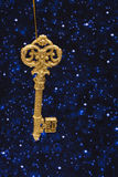 Gold Key Ornament. Of night sky background Stock Photo