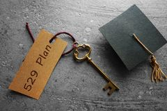 529 college savings planning. Gold key with 529 Plan tag and mini graduation cap -- college savings concept Royalty Free Stock Images