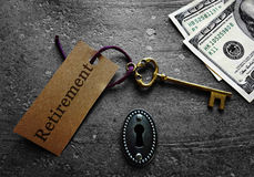 Gold key retirement. Gold key and lock with money and Retirement message Royalty Free Stock Images