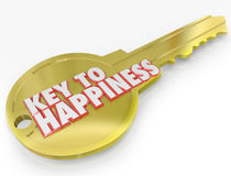Gold Key to Happiness Golden Secret of Success. A golden metal key with the words Key to Happiness symbolizing the secret to success and joy in life Stock Images