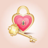 Gold key to heart Stock Image
