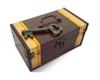 Gold  key on treasure chest. Gold  key on closed treasure chest , isolated with clipping path Stock Photos