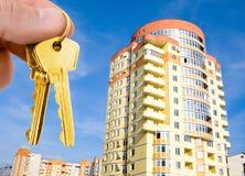 Gold keys with house on blue sky stock photo