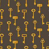 Gold keys seamless vector pattern on brown. Retro cartoon key background. Royalty Free Stock Photography