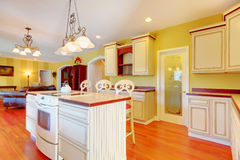 Gold kitchen with white antique cabinets. Gold kitchen with white antique cabinets and cherry hardwood Stock Images