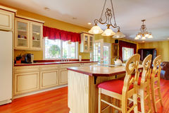 Gold kitchen with white antique cabinets. Gold kitchen with white antique cabinets and cherry hardwood Royalty Free Stock Image