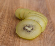Gold kiwi fruit with love heart shaped core Royalty Free Stock Photography