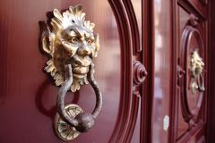 Gold Knockers on Red Door Stock Images